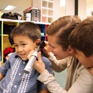 adult-examining-ear