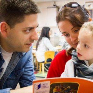 dad-mom-son-reading-book