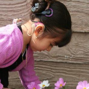 girl-looking-flowers